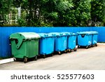 trash cans standing in a row | Shutterstock . vector #525577603