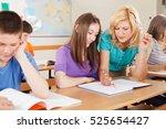 teacher in classroom helping... | Shutterstock . vector #525654427