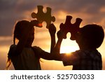 silhouette of two happy... | Shutterstock . vector #525703033