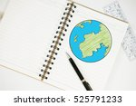 drawing world map on diary | Shutterstock . vector #525791233