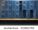 blue metal cage lockers with a...