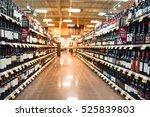 blurred image of wine shelves... | Shutterstock . vector #525839803