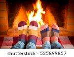 family in christmas socks near...   Shutterstock . vector #525899857