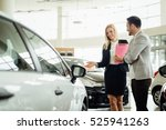salesperson selling cars at car ... | Shutterstock . vector #525941263