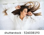 a woman resting in bed with... | Shutterstock . vector #526038193