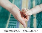 the father keeps  fingers of... | Shutterstock . vector #526068397