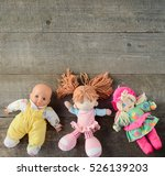 Dolls On Wooden Background. To...