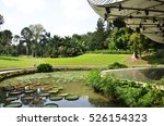 Small photo of SINGAPORE - OCT 31, 2016: The Shaw Foundation Symphony Stage surrounded by a moat filled with lily pads is used for outdoor concerts at the Singapore Botanic Gardens