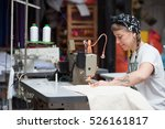 Young Tattooed Seamstress...