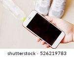 white phone with headphones and ... | Shutterstock . vector #526219783