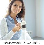 happy woman drinking tea in the ... | Shutterstock . vector #526233013