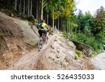 mountain biker riding on bike... | Shutterstock . vector #526435033