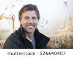 handsome mature happy man... | Shutterstock . vector #526640407