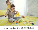 mother with child playing... | Shutterstock . vector #526708447