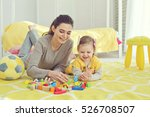 mother with child playing... | Shutterstock . vector #526708507