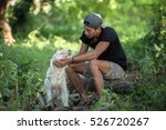man with his dog in the park | Shutterstock . vector #526720267