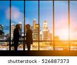 silhouette businessmen shake... | Shutterstock . vector #526887373