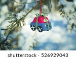 toy car on a fir tree branch in ... | Shutterstock . vector #526929043
