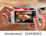 woman taking photo of tasty... | Shutterstock . vector #526938343