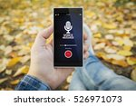 man in the park recording voice ... | Shutterstock . vector #526971073