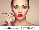 beautiful woman paints lips... | Shutterstock . vector #527004637
