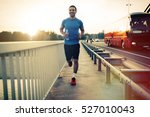 fit athlete running outdoors to ... | Shutterstock . vector #527010043