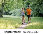 couple jogging and running... | Shutterstock . vector #527013337