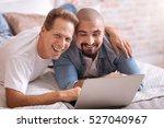 positive gay couple lying on... | Shutterstock . vector #527040967