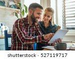 couple spending money online on ... | Shutterstock . vector #527119717