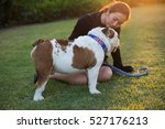 woman and bulldog on the grass | Shutterstock . vector #527176213