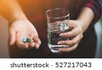 woman teenager hands with pills ... | Shutterstock . vector #527217043