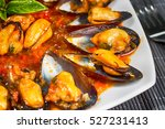 fried mussels in a sauce of... | Shutterstock . vector #527231413
