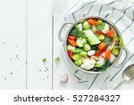 Various fresh vegetables in a...