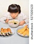 girl enjoy japanese cuisine | Shutterstock . vector #527320123