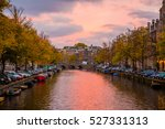 Stock photo waterfront canal near the python bridge amsterdam amazing sunset view over the canal 527331313