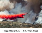 white aircraft dropping fire... | Shutterstock . vector #527401603