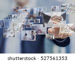 Stock photo businessman touching a photo on a digital screen interface abstract images of business situations 527561353