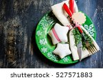 Small photo of Festive table setting for Christmas eve in rustic style on dark wooden background