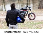 biker standing near motorcycle... | Shutterstock . vector #527743423