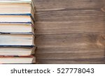 old books on wooden background | Shutterstock . vector #527778043