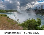 Small photo of Niagara Falls from the American side. American Falls, Horseshoe falls and Canada Skyscrapers on the background.