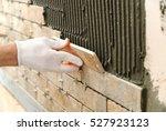 installing the tiles on the...   Shutterstock . vector #527923123