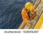 man working overboard. abseiler ... | Shutterstock . vector #528056287