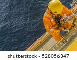 man working overboard. abseiler ... | Shutterstock . vector #528056347
