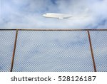 Steel Fence With Plane Flying...