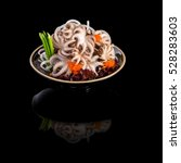 Sashimi With Octopus In A Blac...