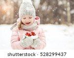 happy child in winter park is... | Shutterstock . vector #528299437