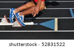 Teen Boy Leaving the Starting Blocks at the Start of a Race - stock photo