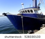 vintage fishing boat moored... | Shutterstock . vector #528330133