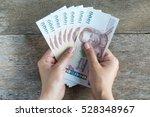 thai money in hand for saving...   Shutterstock . vector #528348967